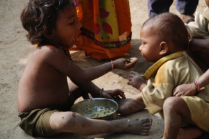 child feeding another